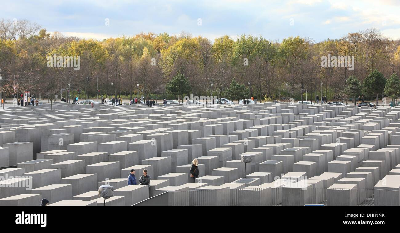Berlin, Germany. 09th Nov, 2013. Visitors walk around the Holocaust memorial in Berlin, Germany, 09 November 2013. This weekend the Crystal Night is reminiscened with numerous events. Photo: STEPHANIE PILICK/dpa/Alamy Live News - Stock Image