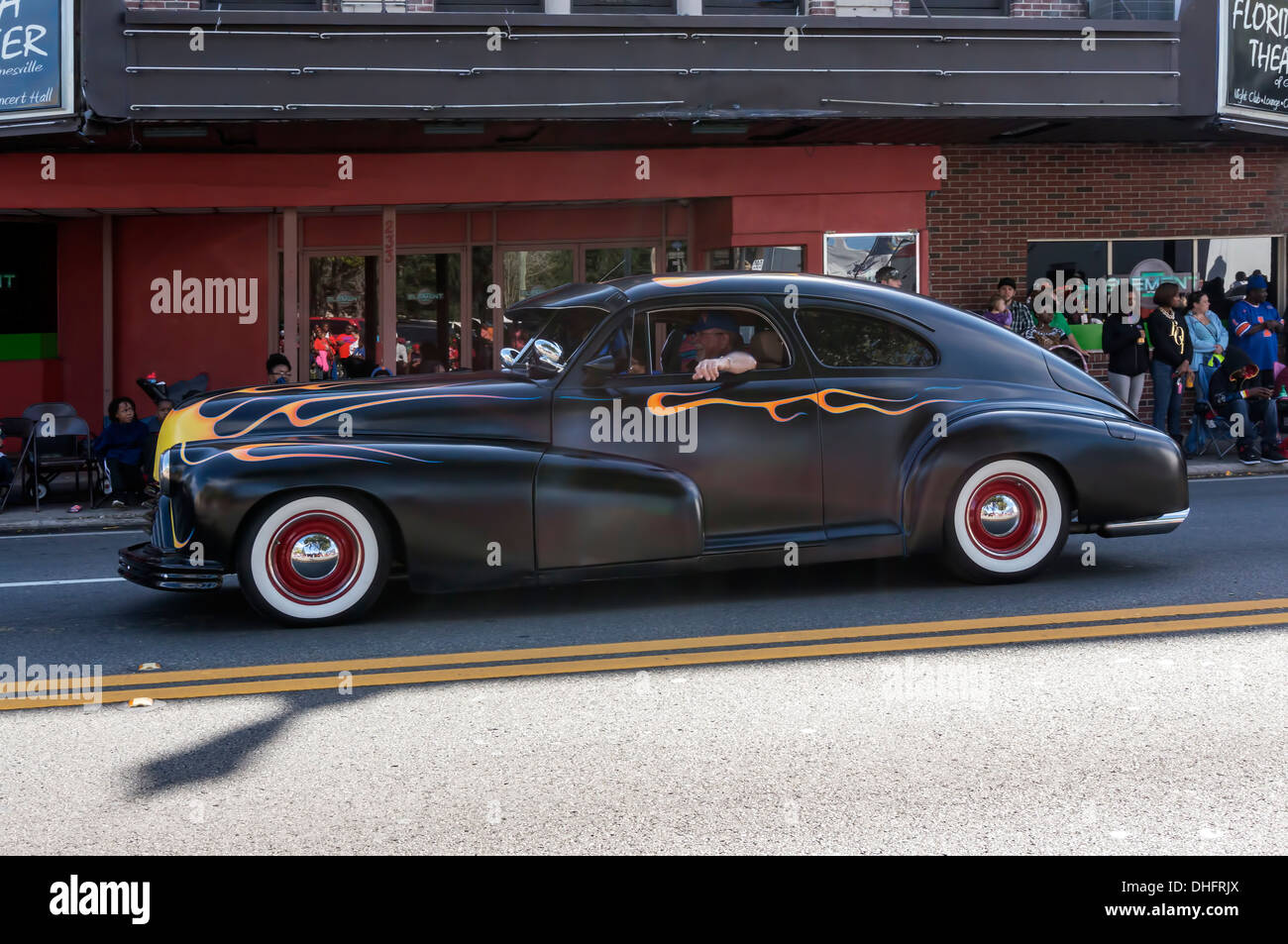 Matte black 1948 Oldsmobile two door fastback with hand painted flames in the University of Florida 2013 Homecoming Parade. - Stock Image