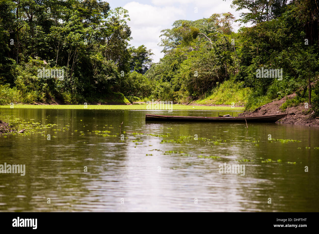 A canoe on an inlet off of Lake Yarinacocha in Pucallpa, Peru, - part of the river Ucayali, which flows into the Amazon river. - Stock Image