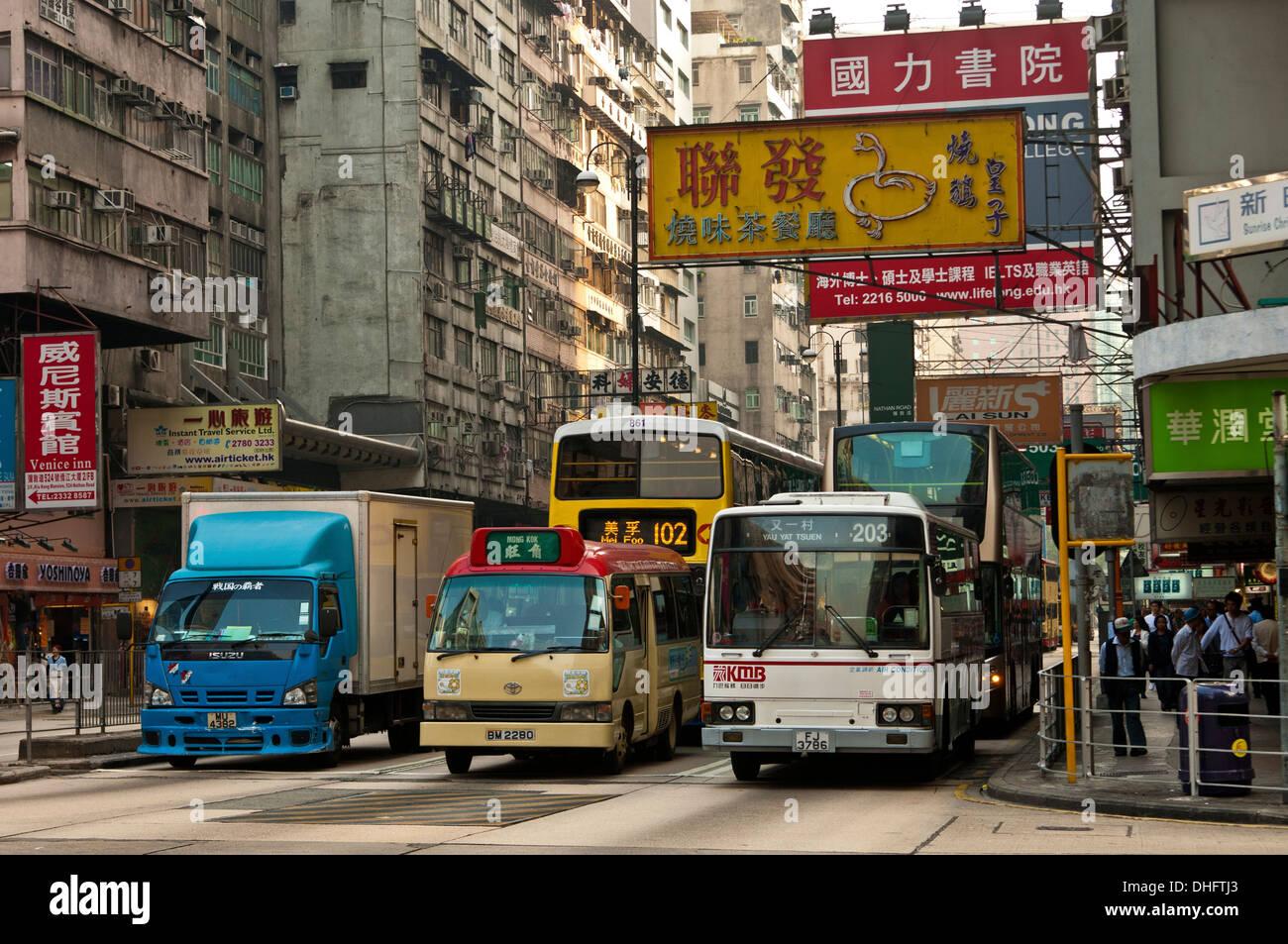 Dense traffic at a crossing with Nathan Road, Kowloon, Hong Kong Stock Photo