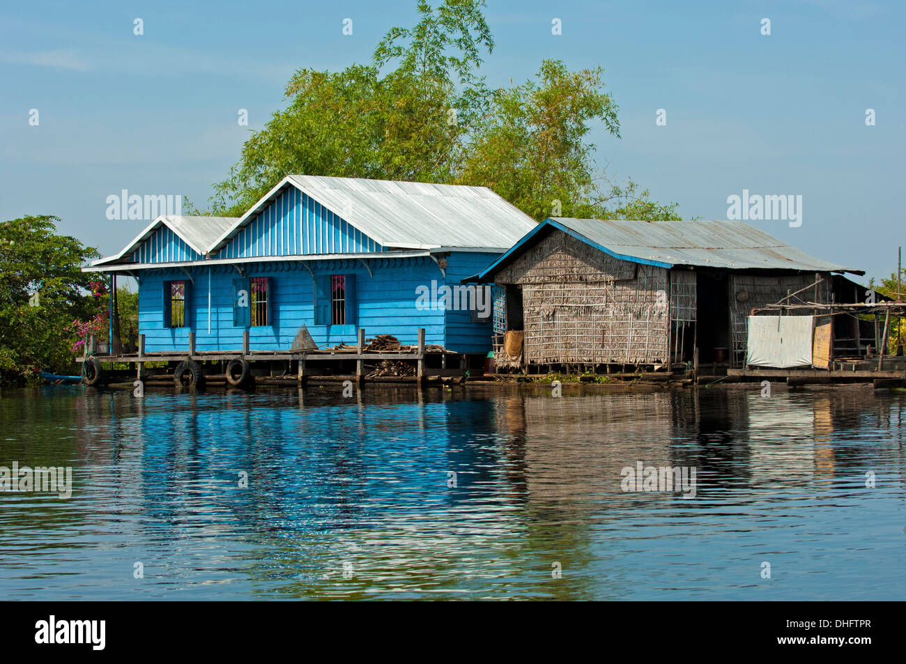 Dwellings of a floating village on the Tonle Sap lake, Cambodia - Stock Image