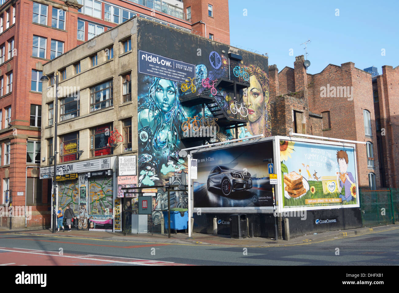 Graffiti on the side of Ridelow Bike shop in Church Street, Northern Quarter of Manchester. - Stock Image