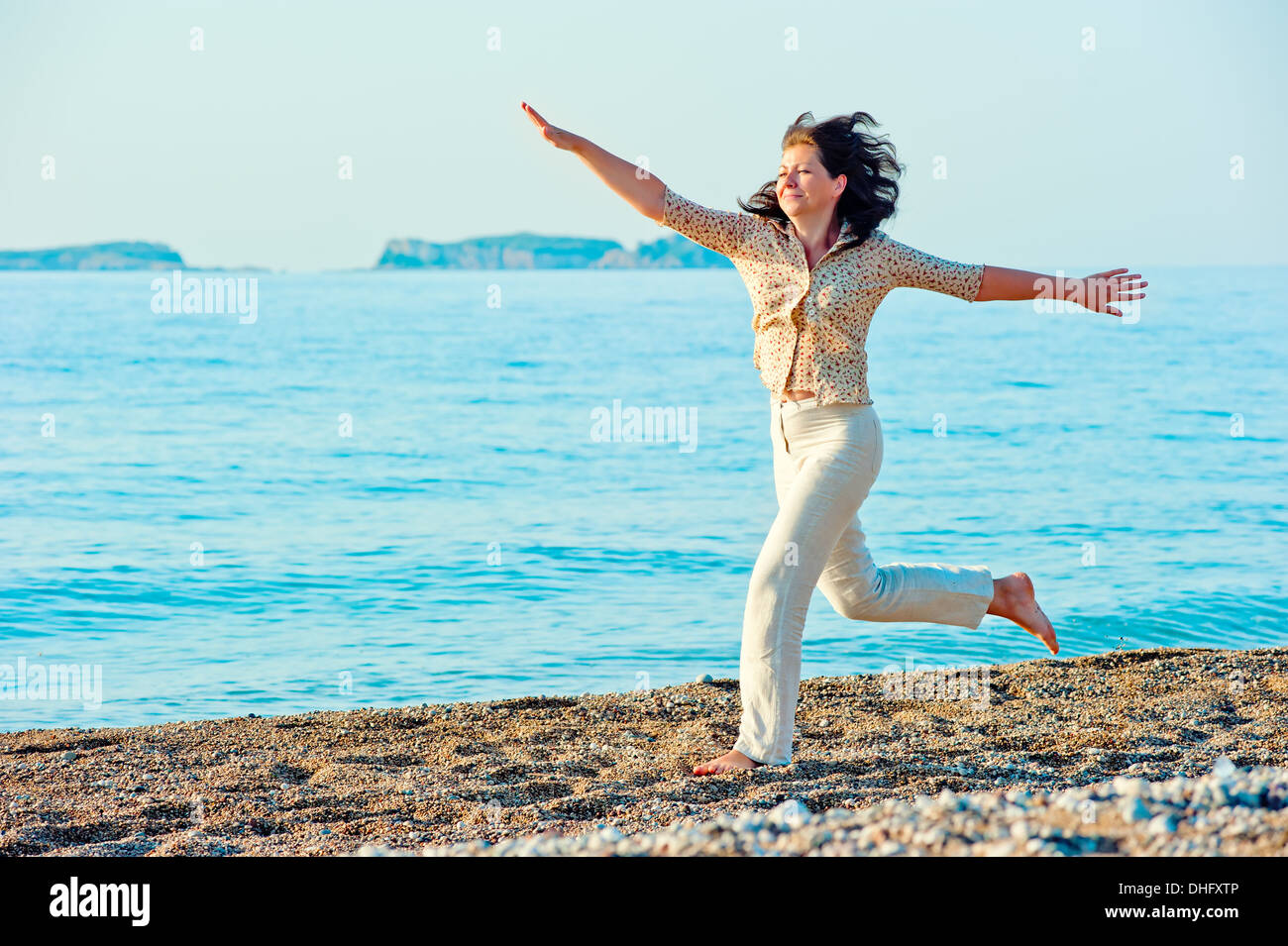 she actively moving on the shore near the sea - Stock Image