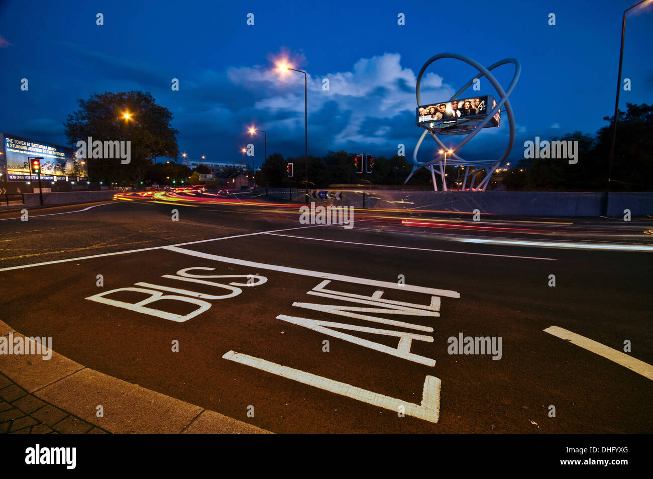 Bus Lane at dusk on a busy roundabout Stock Photo