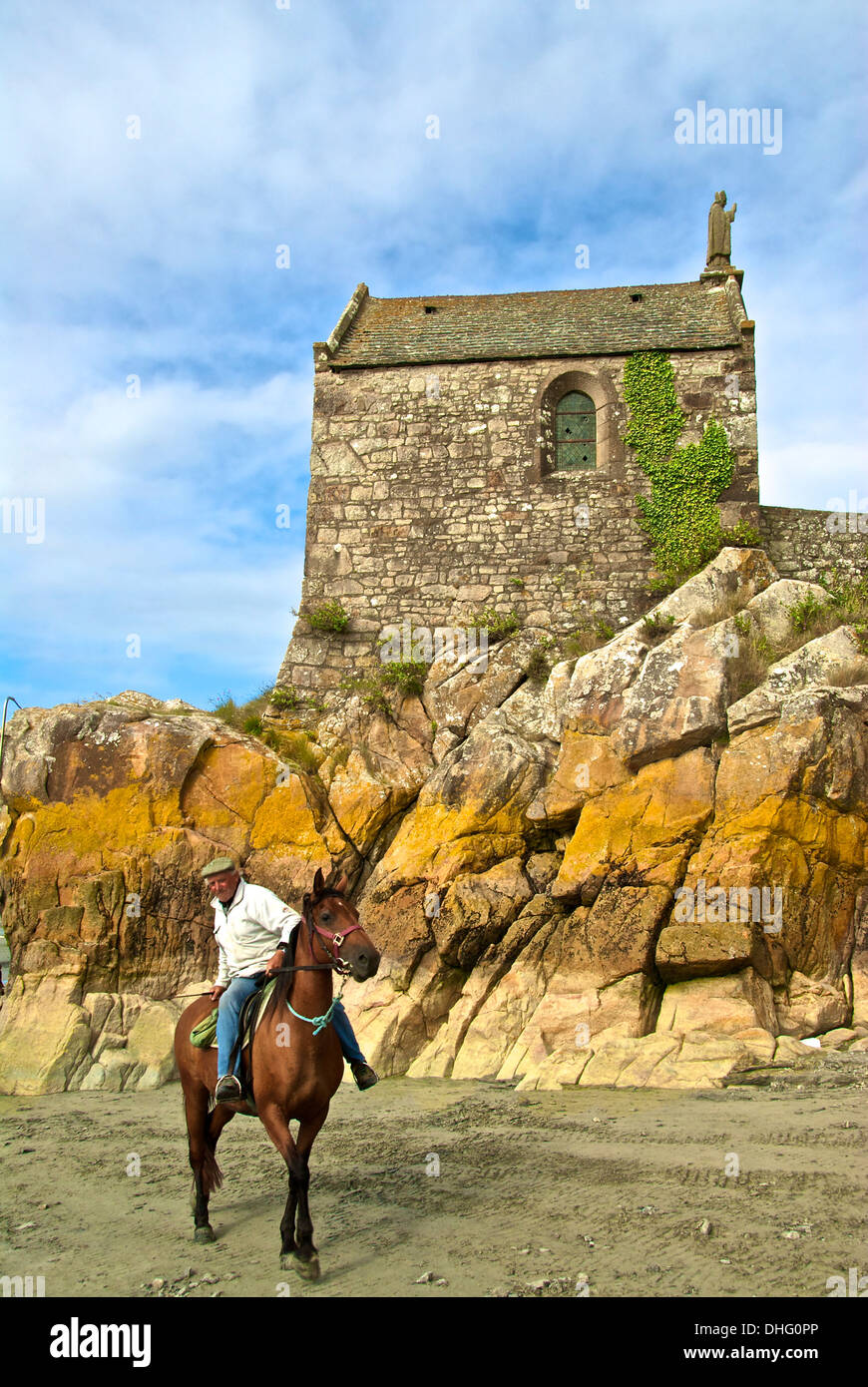 Mont Saint Michel rider and St Asberts chapel - Stock Image