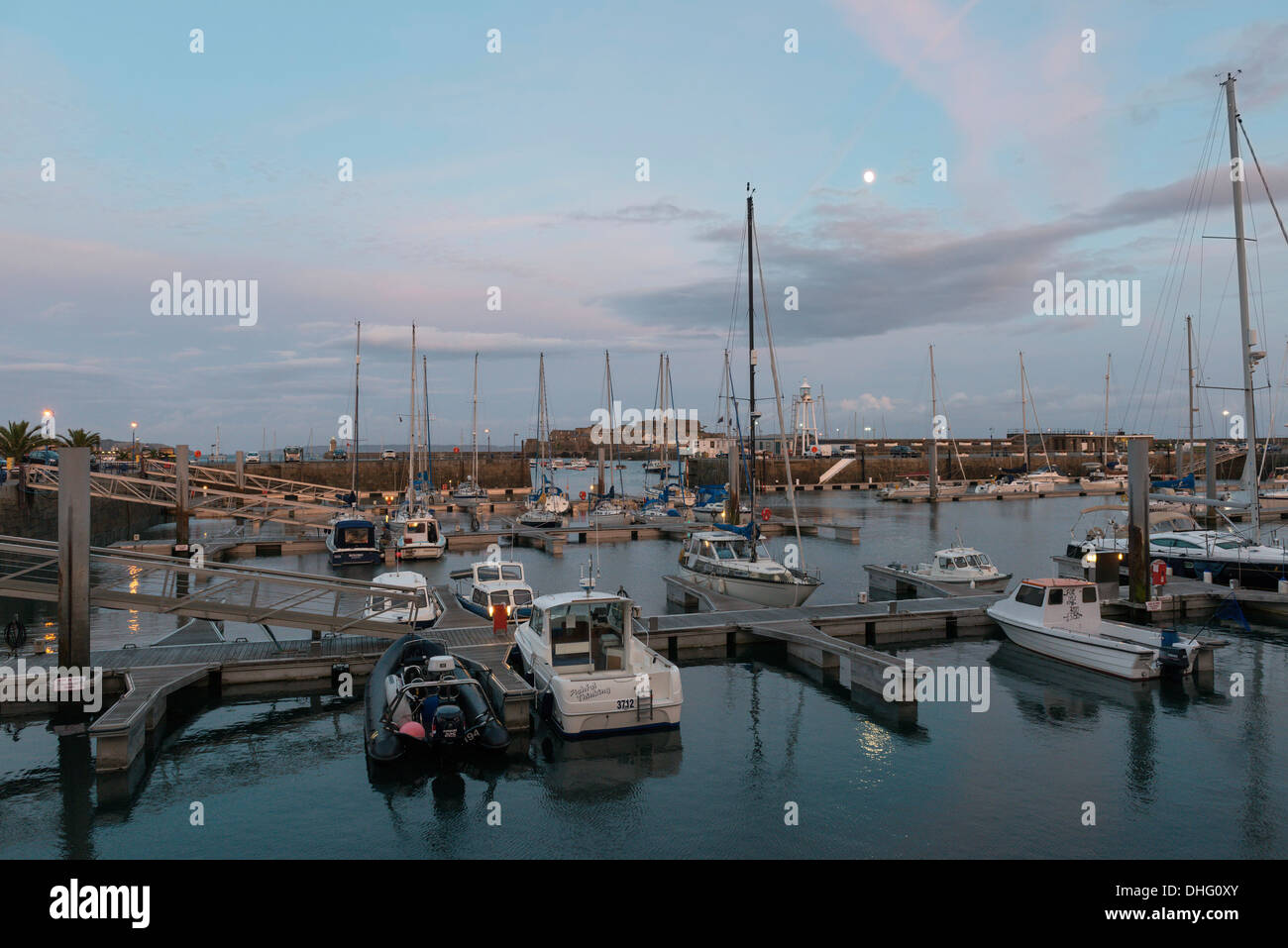 St Peter Port Harbour at dusk, Guernsey, Channel Islands - Stock Image