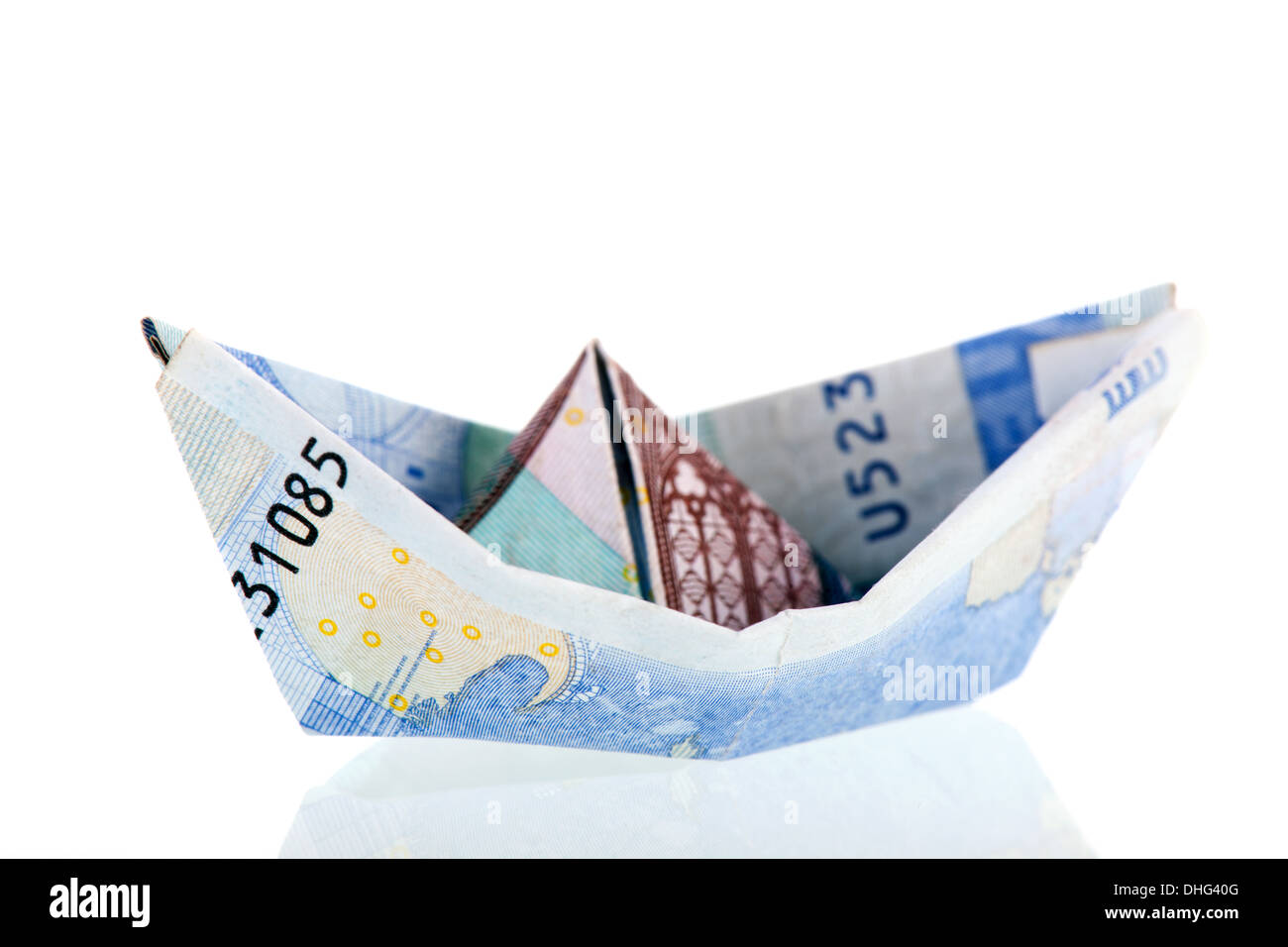 Boat from Euro bank notes isolated over white background Stock Photo