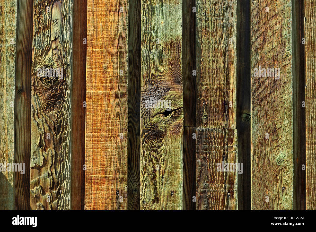 A section of cedar boards used as outdoor siding on a building - Stock Image
