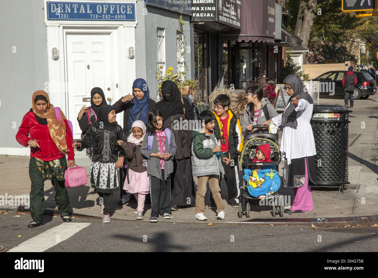 Muslim moms bringing kids home after school along Cortelyou Road in Ditmas Park, Brooklyn, NY. - Stock Image