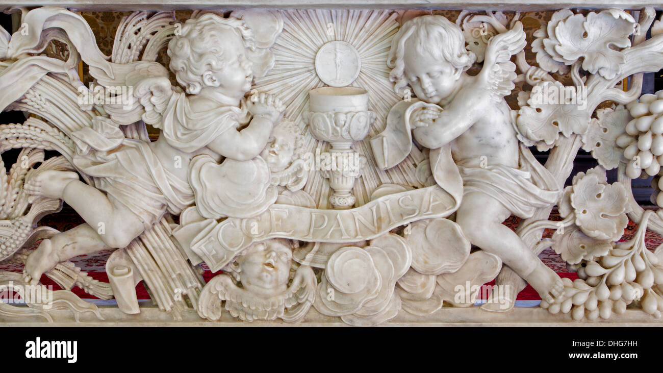 Antwerp - Baroque relief in marble. Obeisance of antels for eucharist in St. Jacobs church (Jacobskerk) - Stock Image
