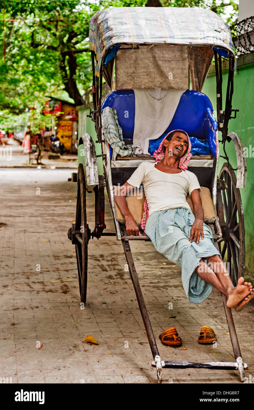 Candid, a Rickshaw puller taking a afternoon nap, Calcutta, Bengal, India - Stock Image