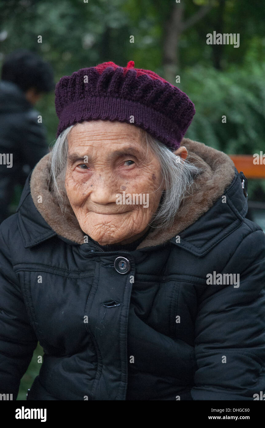 Elderly woman, warmly dressed, in Chengdu, Sichuan, China - Stock Image