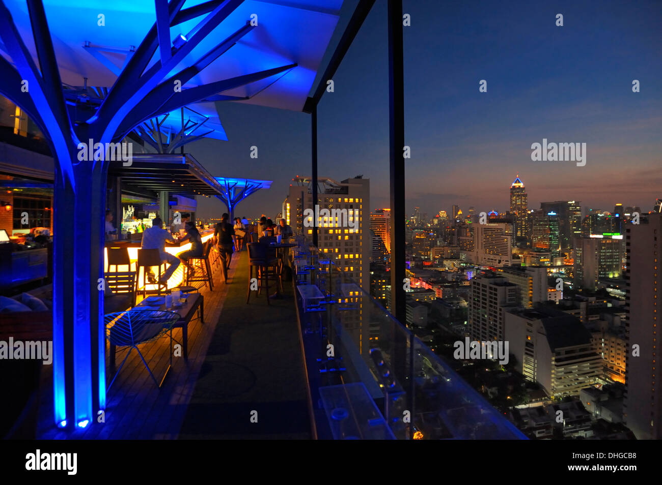 Bangkok's skyline after sunset as seen from Above 11 Bar and Restaurant, 33rd floor of Fraser Suites Sukhumvid, Bangkok. - Stock Image