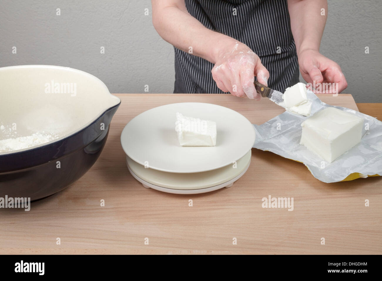 cutting and weighing fat - Stock Image