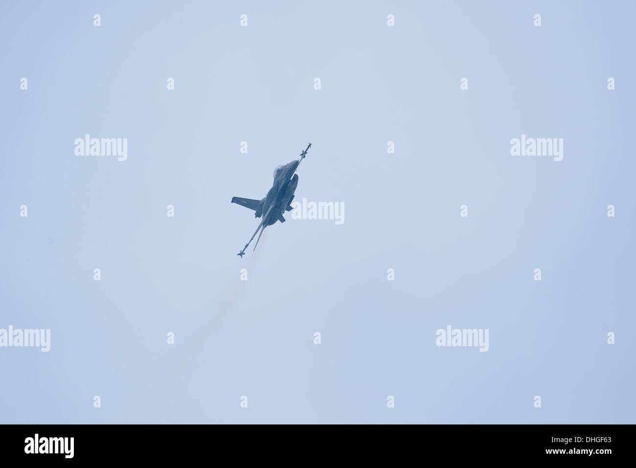 The F-16C during a high G maneuver over Thessaloniki. Due to the annual celebration of the Hellenic Air Force every November, an F-16 Block 52+ belonging to the 'Zeus' acrobat team made an air show at Thessaloniki seaside area. The purpose of the demonstration is people come closer with the Air Force - Stock Image