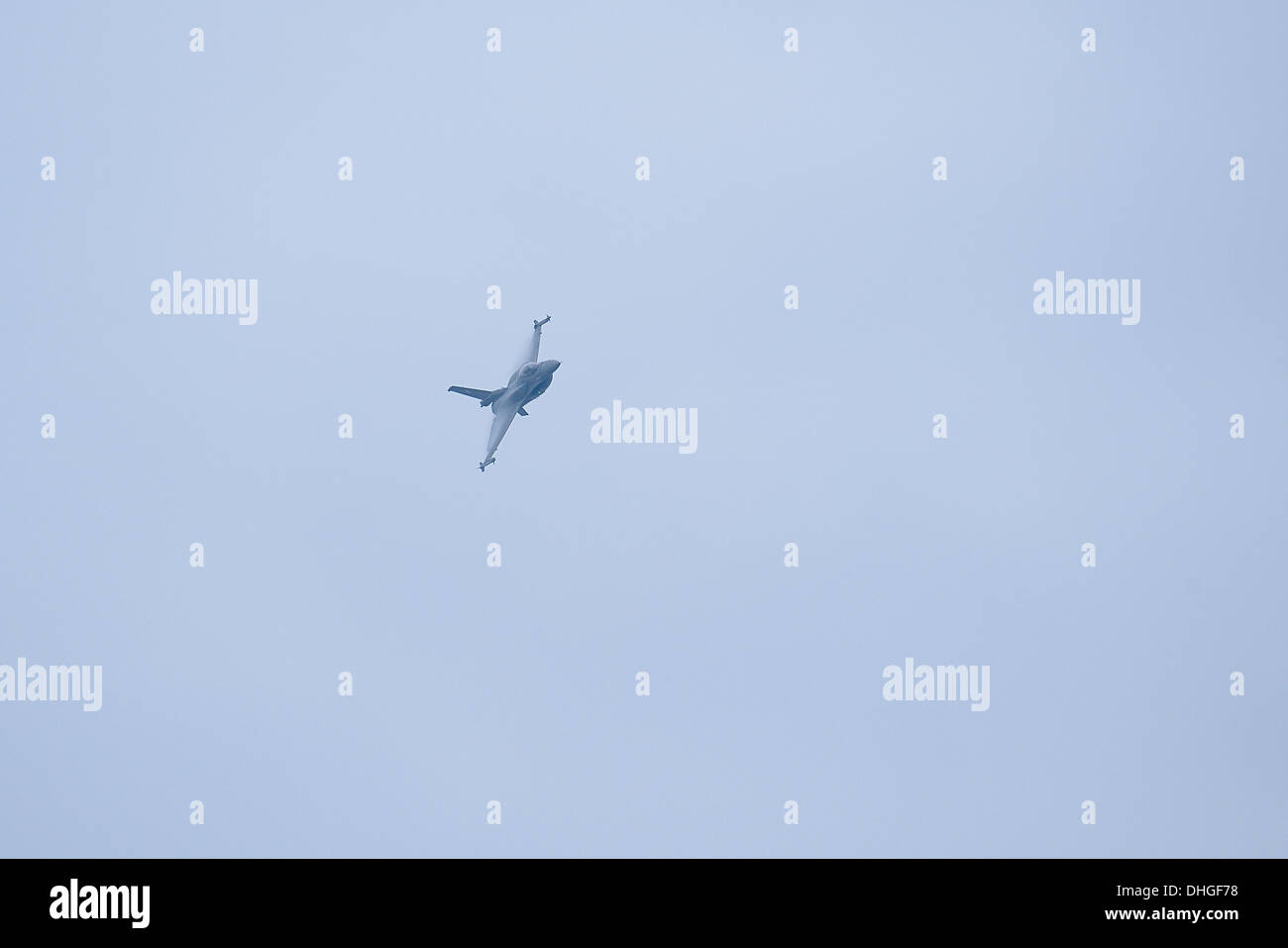 The F-16C during a high G maneuver over Thessaloniki - Stock Image