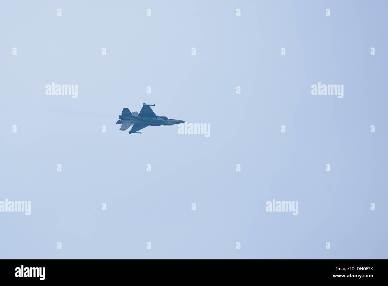 The F-16C during an inverted flight over Thessaloniki - Stock Image