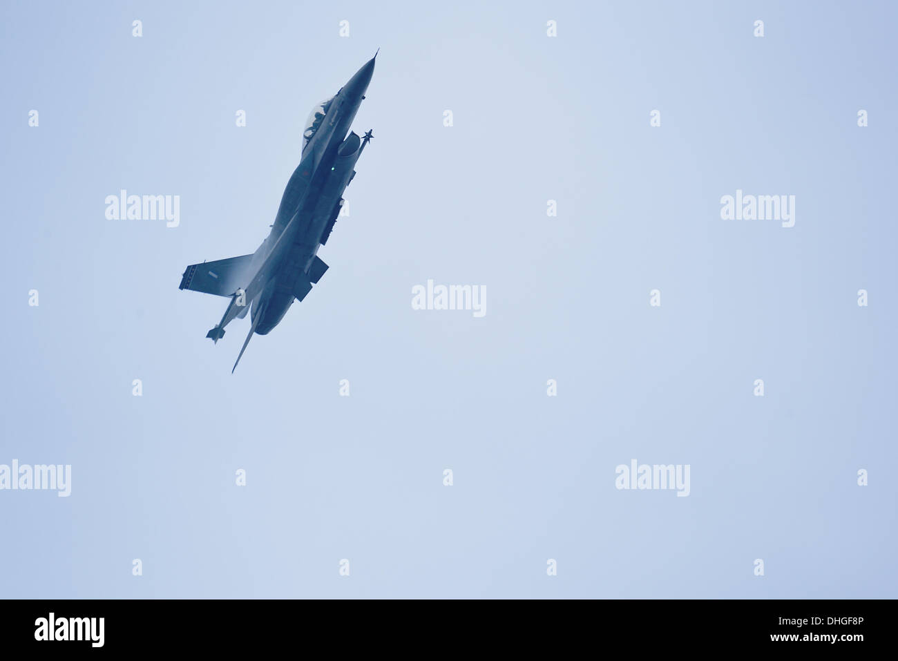 The F-16C during a high G maneuver during the airshow over Thessaloniki - Stock Image