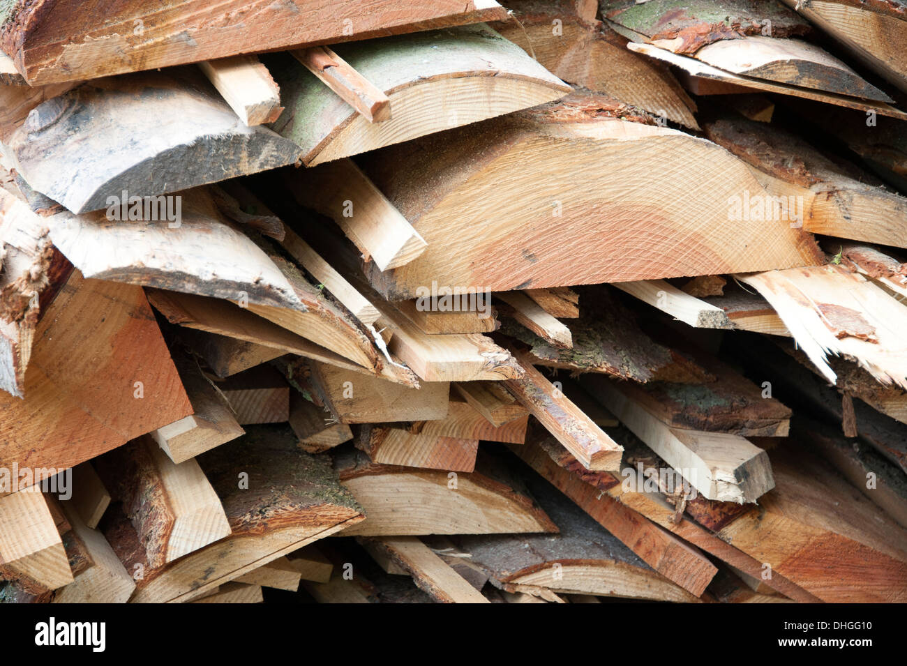 Saw Mill tree trunks cut timber planks of wood new - Stock Image