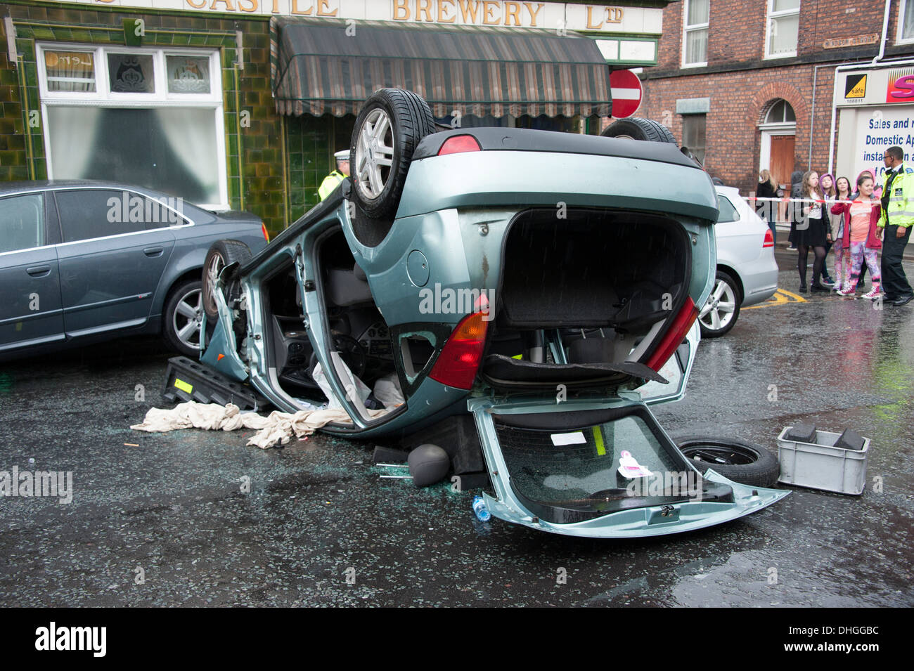 Car Crash overturned on roof rescue - Stock Image