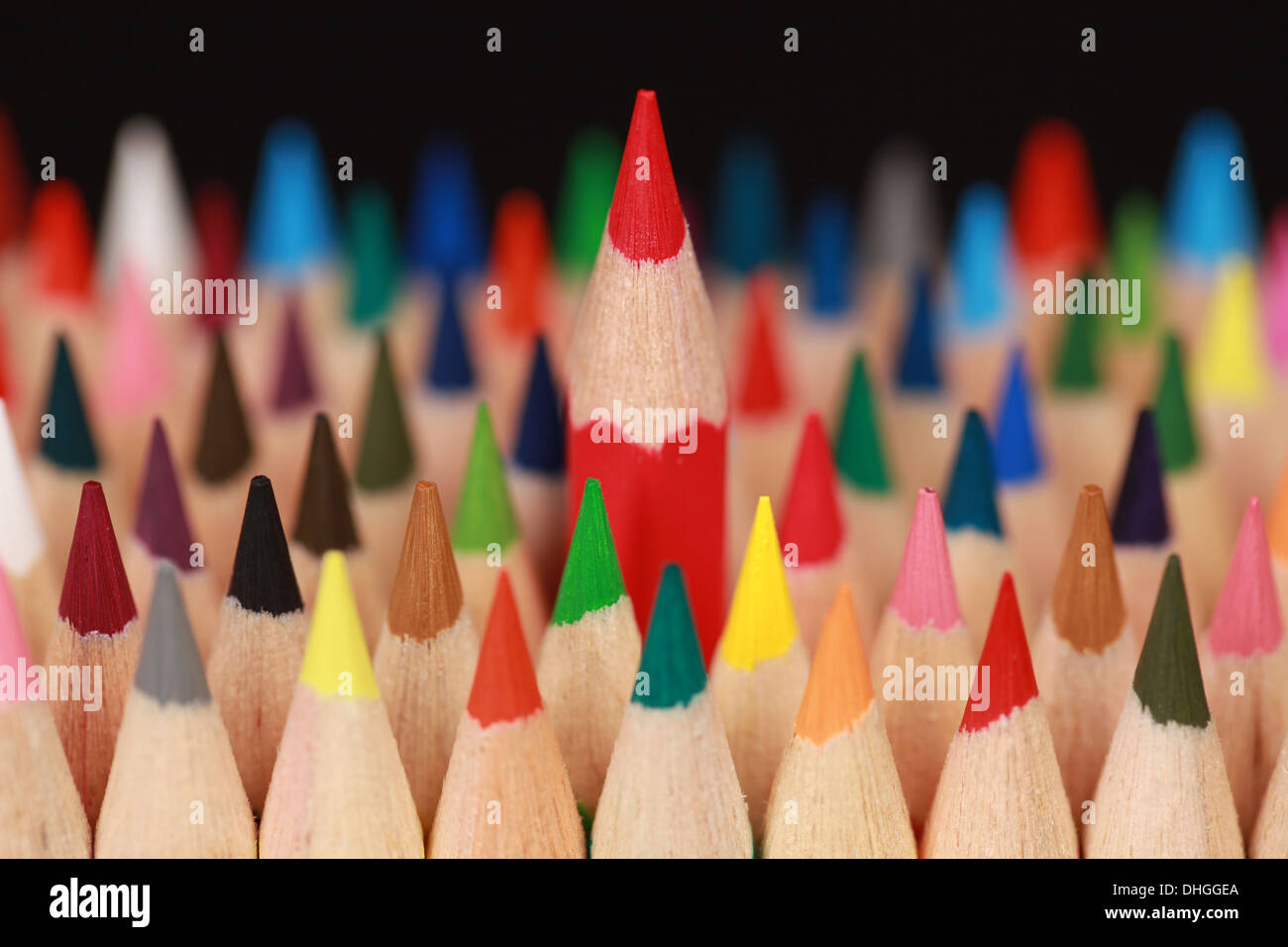 Concept picture red pencil standing out from the crowd - Stock Image