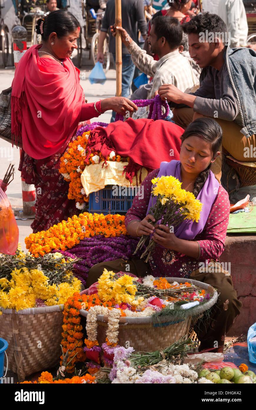 Flower seller in Kathmandu. - Stock Image
