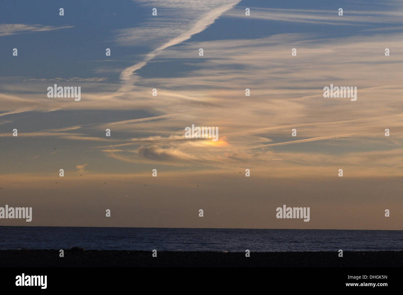 Newhaven, UK. 10th Nov, 2013. Unusual clouds and sky lighting over the sea at Newhaven. Sunset was to the right of this picture out of shot . This is probably a phenomena known as  'Circumhorizon Arc'. Credit:  David Burr/Alamy Live News - Stock Image
