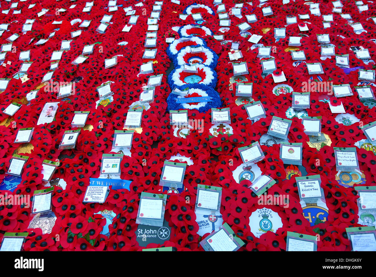 London, UK. 10th November 2013. Red Remembrance Day poppies and poppy wreaths at the Cenotaph on Remembrance Sunday, London, England - Stock Image