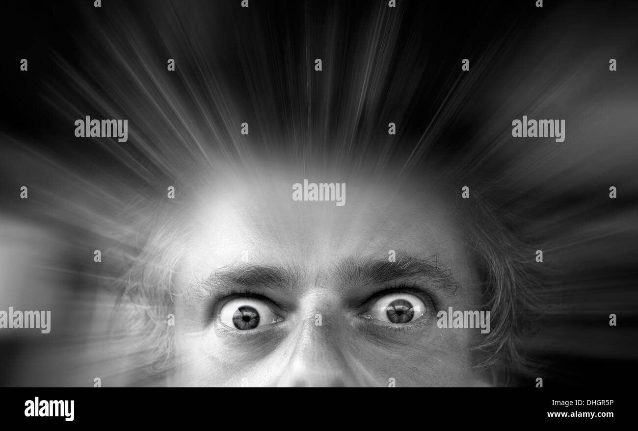 Zoom effect on wide eyed staring male. - Stock Image