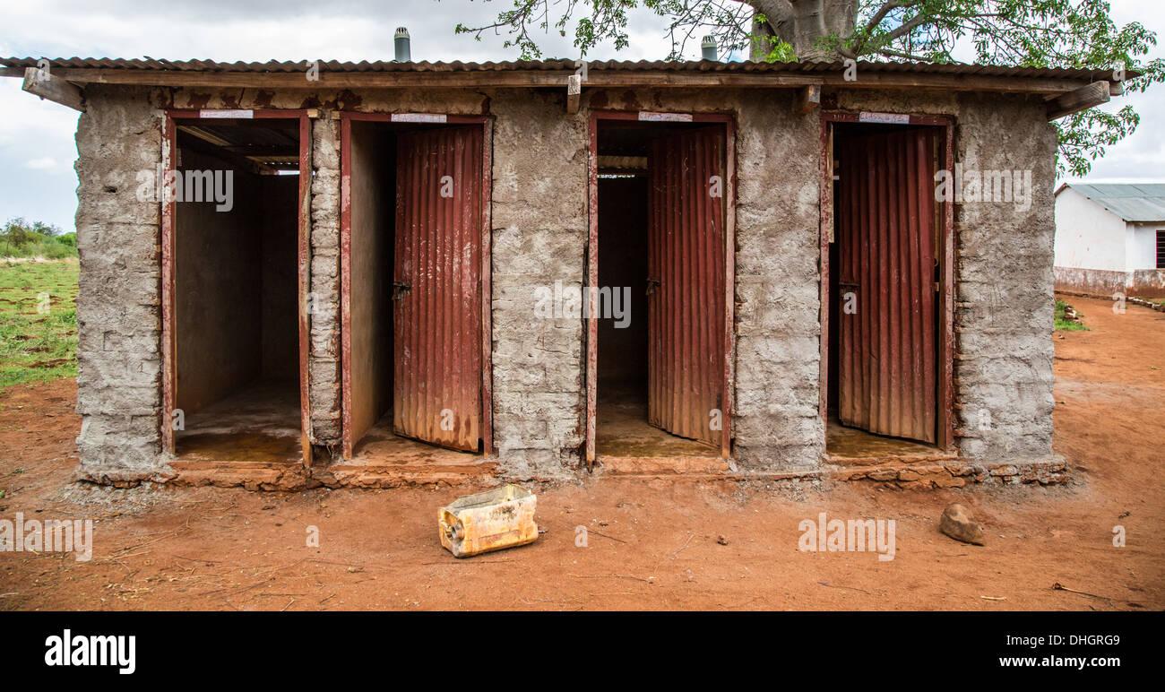 Basic toilet block in the school yard of a Kenyan village near Voi Stock Photo