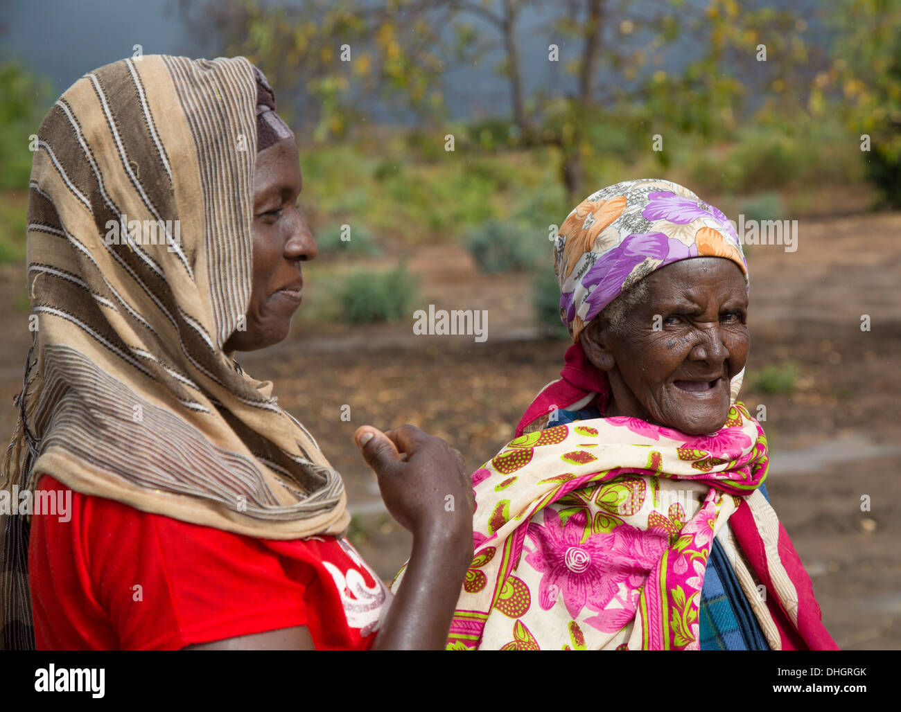 Two colourfully dressed women in a village in the Sagalla region of Southern Kenya Stock Photo