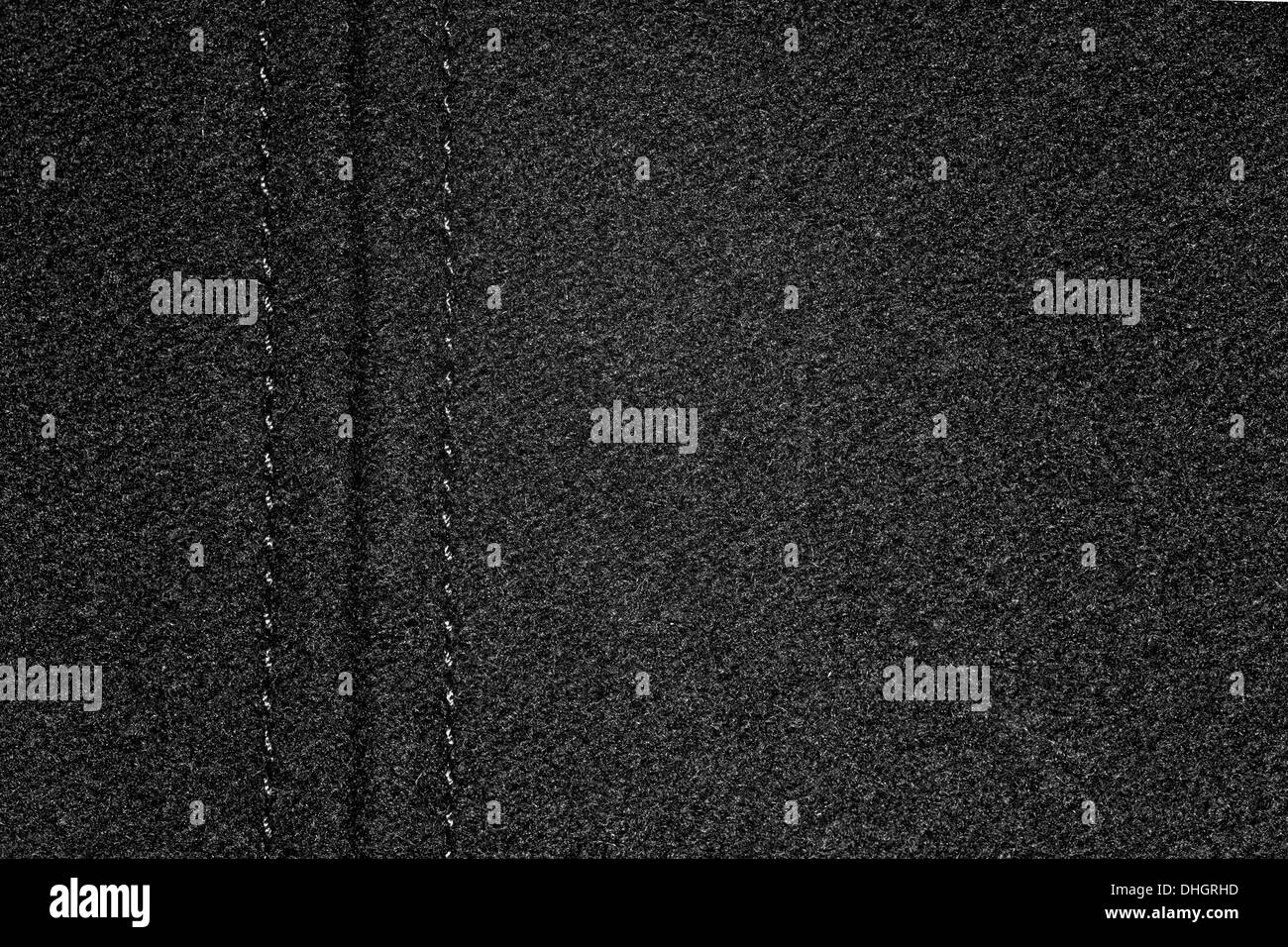 black canvas background with margin or grain cloth texture - Stock Image