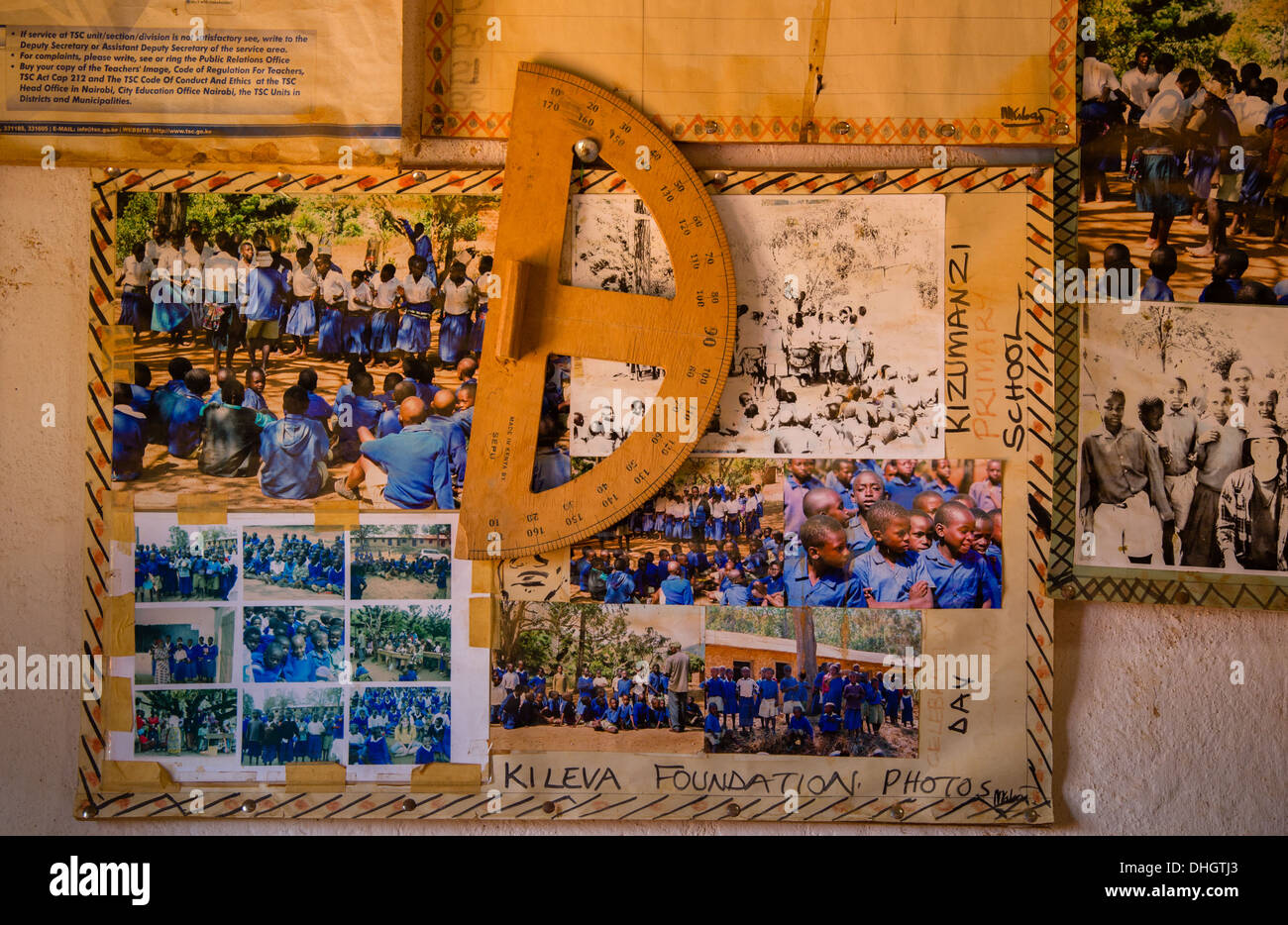 Wooden protractor hanging on a wall with school photographs in a Kenyan school in the Sagalla Hills near Voi in Kenya - Stock Image