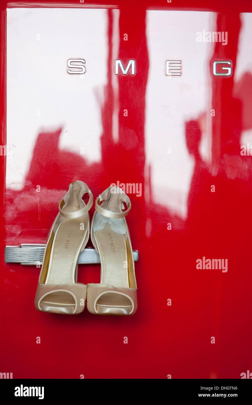 Bridal shoes hung red wedding refrigerator door art artistic shot inspiration inspire marriage preparation photographer creative - Stock Image