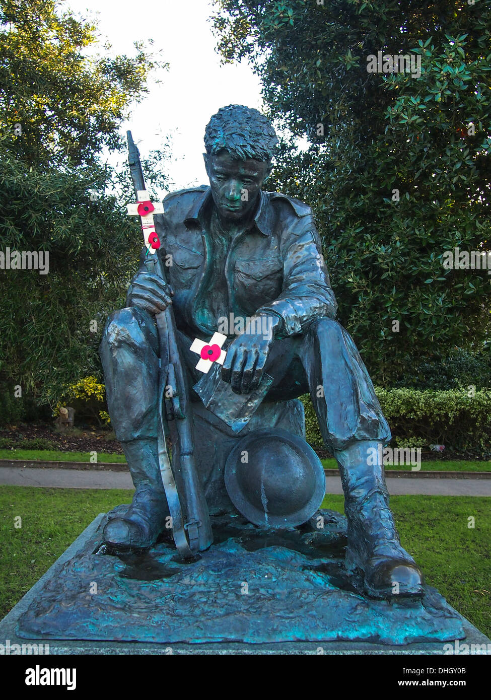 The statue of a 'Soldier of world war two'  with crucifixes and poppies outside the D-day museum in Southsea Portsmouth England - Stock Image