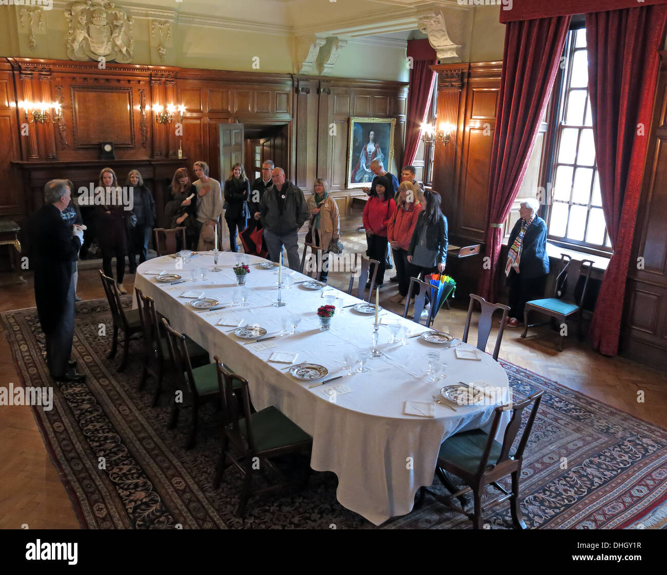 Dining room at Dunham Massey NT with visitors, Altrincham, Manchester, England UK - Stock Image