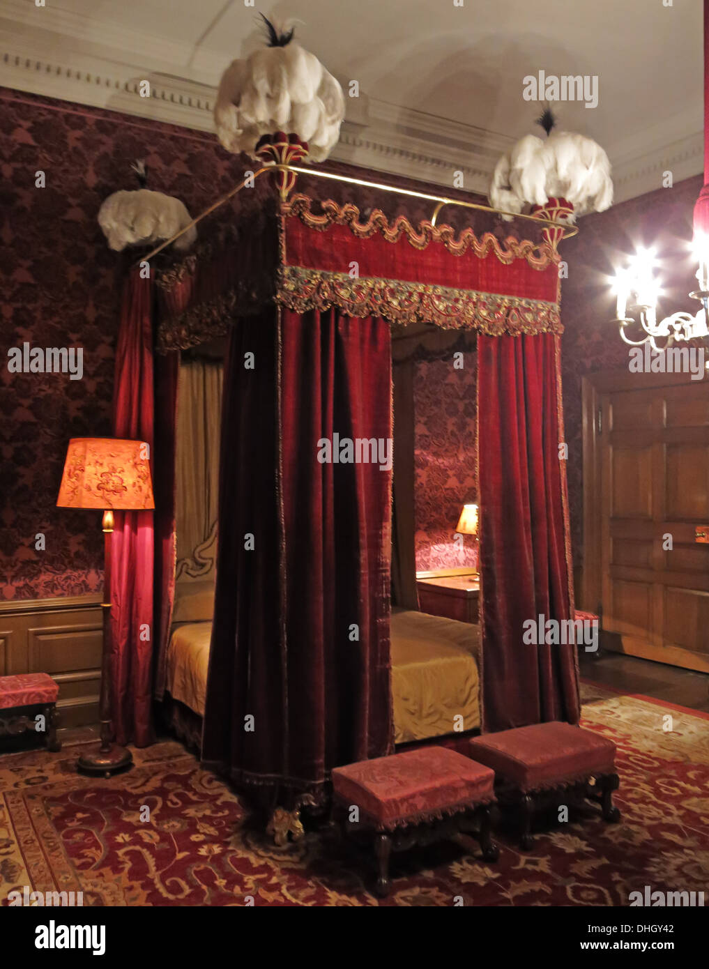 Red Bedroom, Dunham Massey, in the evening. NT near Altrincham, Cheshire, England, UK - Stock Image