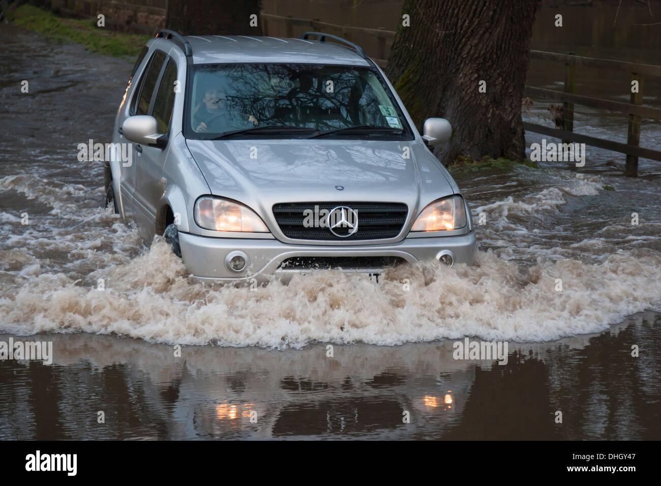 Car driving through flood - Stock Image