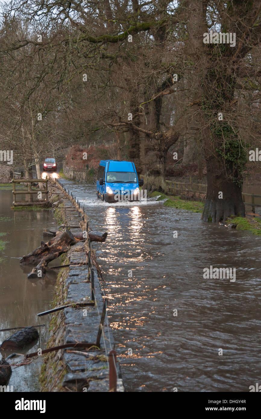 Van driving through flood - Stock Image