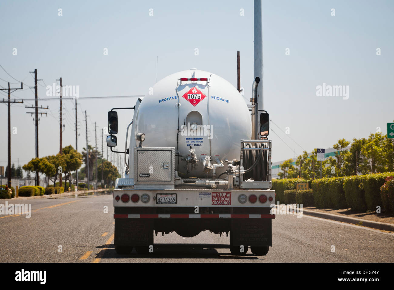 Rear view of propane tank truck on road - California USA - Stock Image