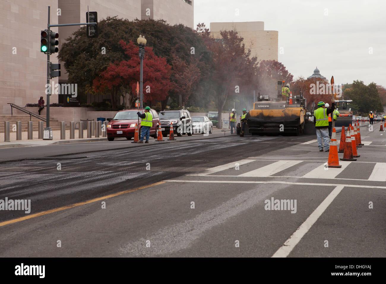 Asphalt road resurfacing crew at work - Washington, DC USA - Stock Image