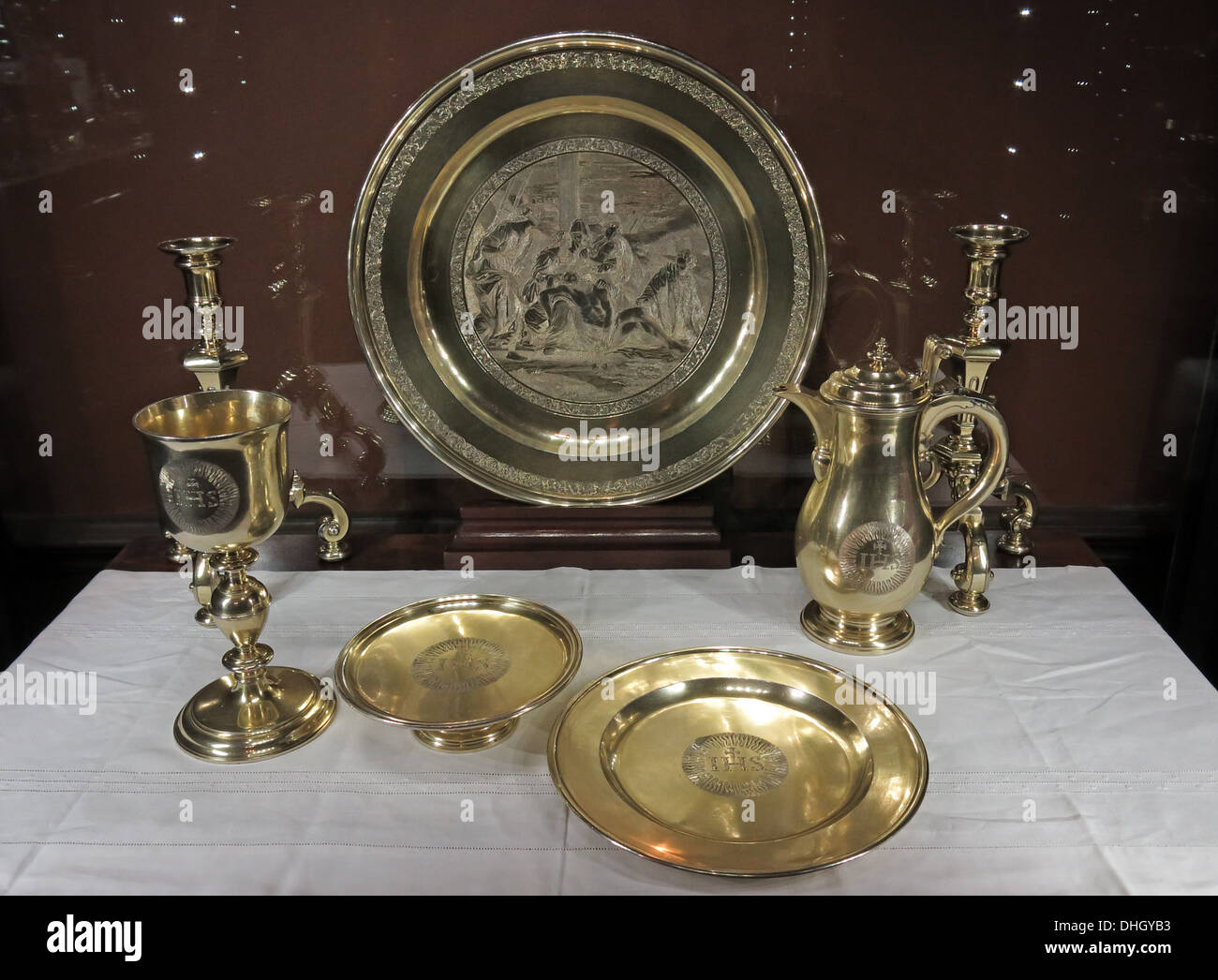 Silverware,Goldware plate and trays at Dunham Massey house NT property, Altrincham, Greater Manchester, England, UK - Stock Image