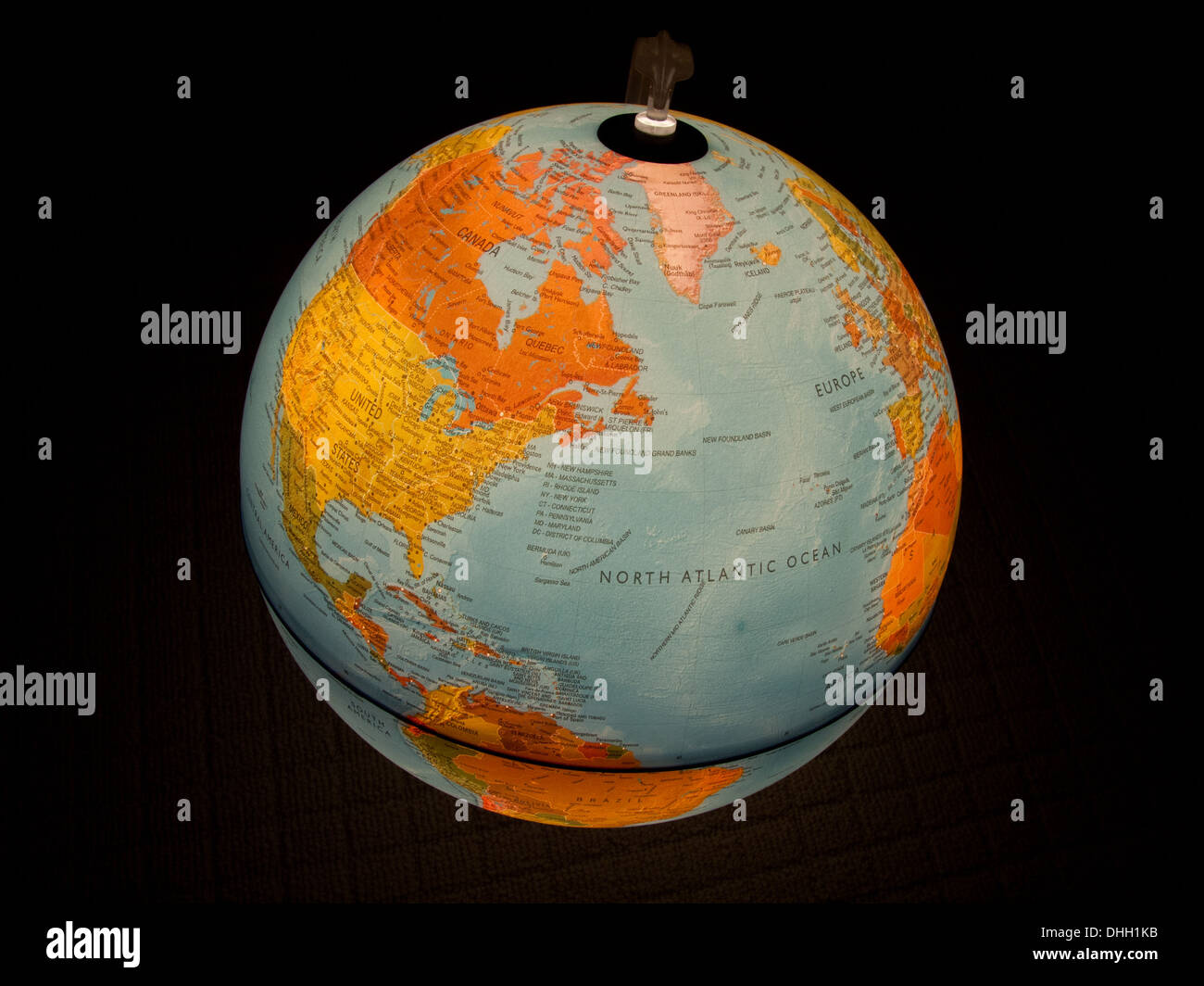 Planet Earth as depicted on a lighted globe. - Stock Image