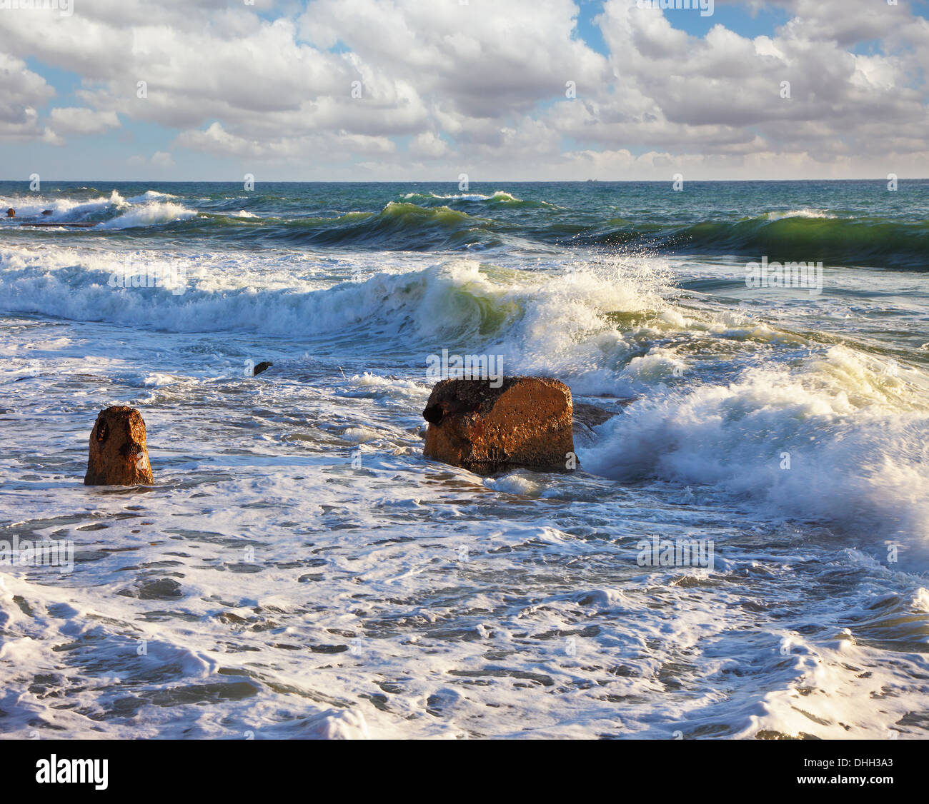 Sea foam shines on the sun, a sunset - Stock Image