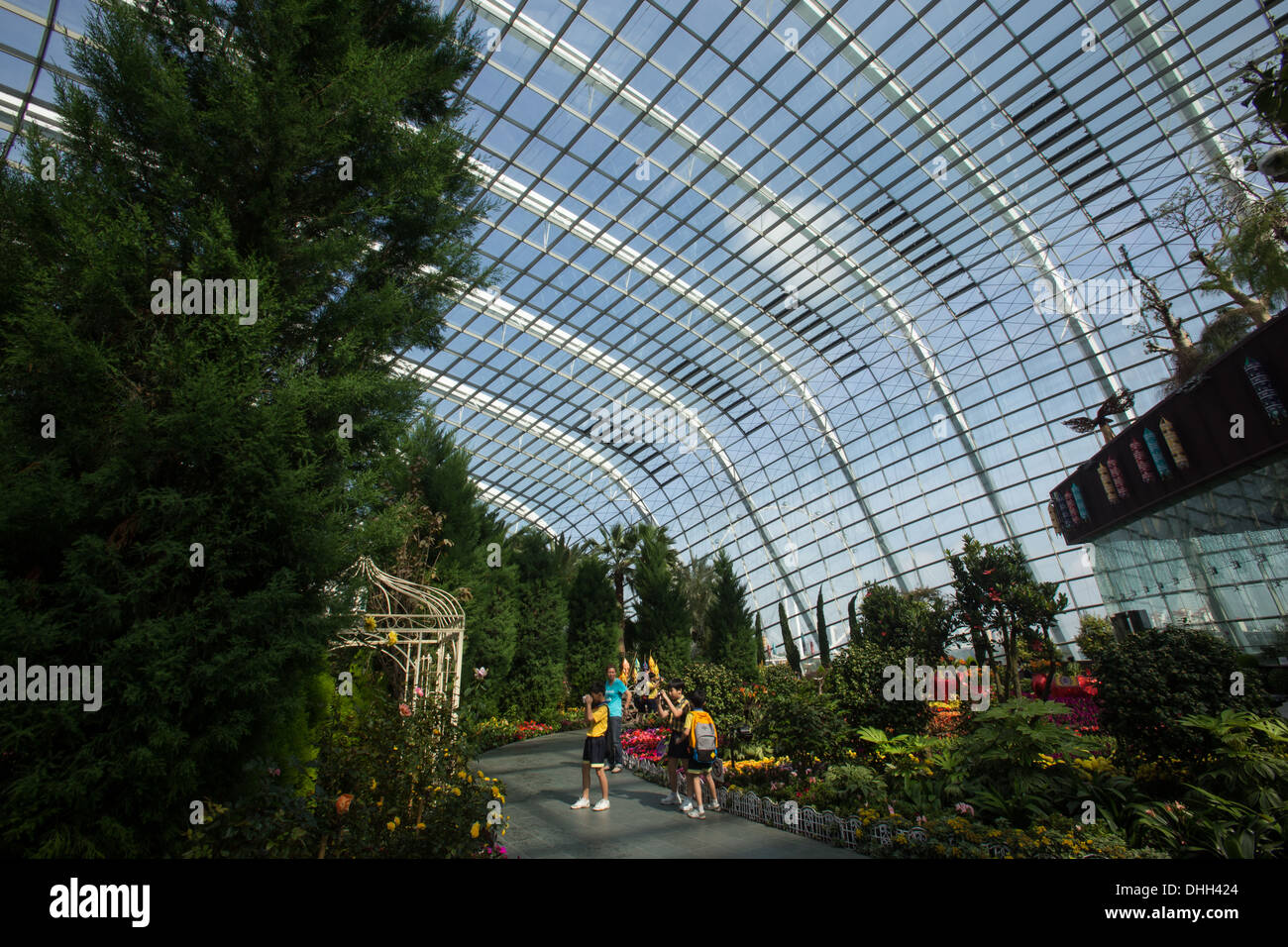 The Flower Dome at Gardens by the Bay is an artificially created realm of perpetual spring. - Stock Image