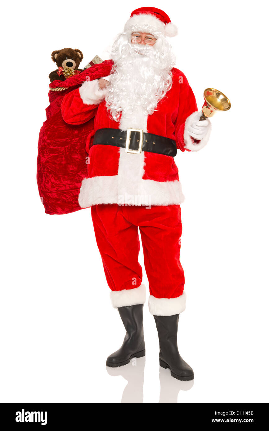 Santa Claus or Father Christmas carrying a sack full of gift wrapped ...