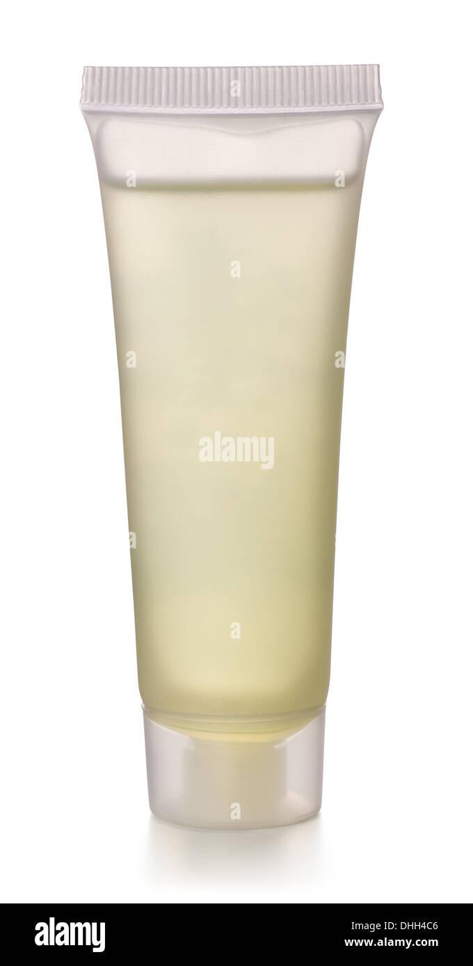 Transparent plastic cosmetics tube isolated on white - Stock Image