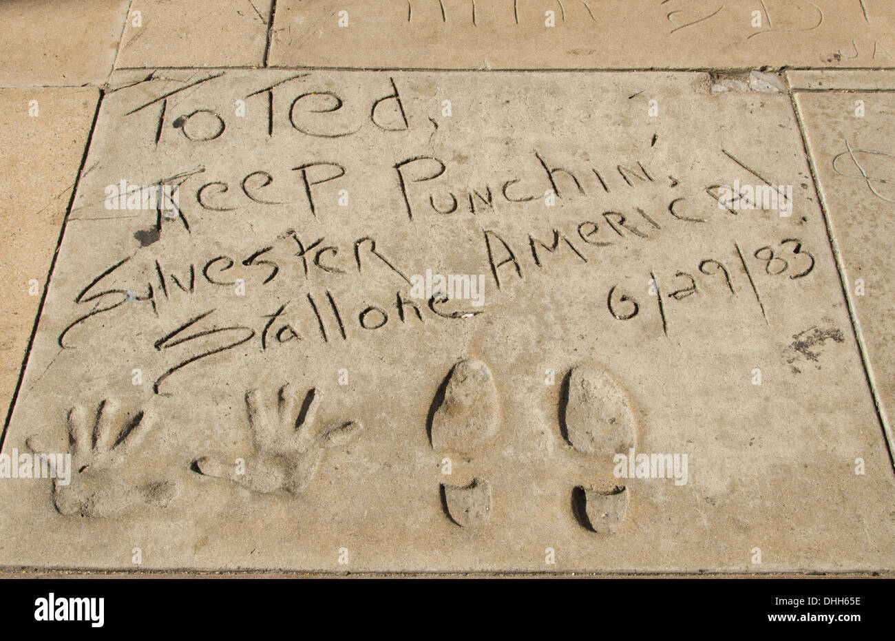 Los Angeles California CA Silvester Stallone hands and feet in cement at the famous TCL Chinese Theater - Stock Image