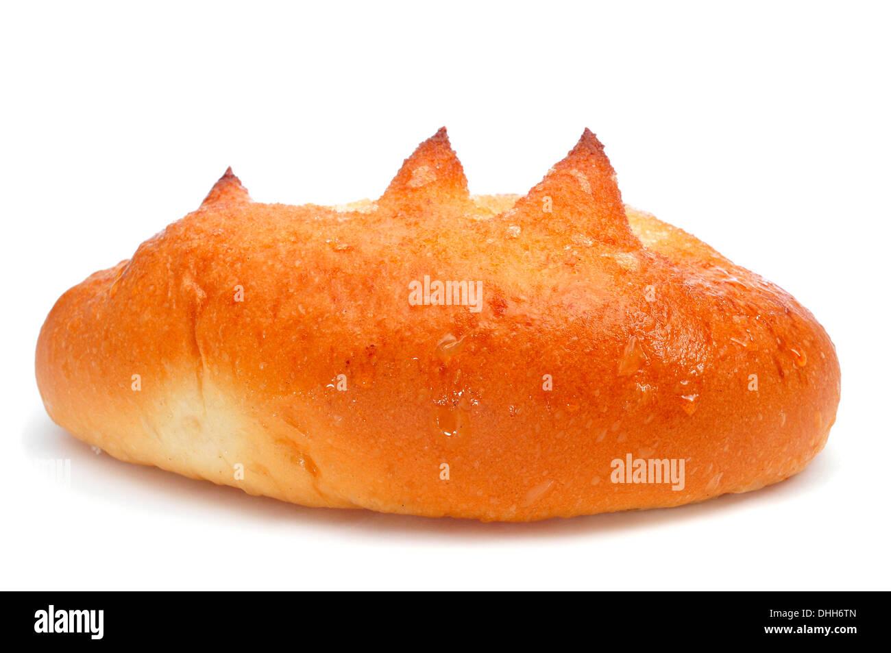 spanish bollo suizo, a brioche with sugar, on a white background - Stock Image