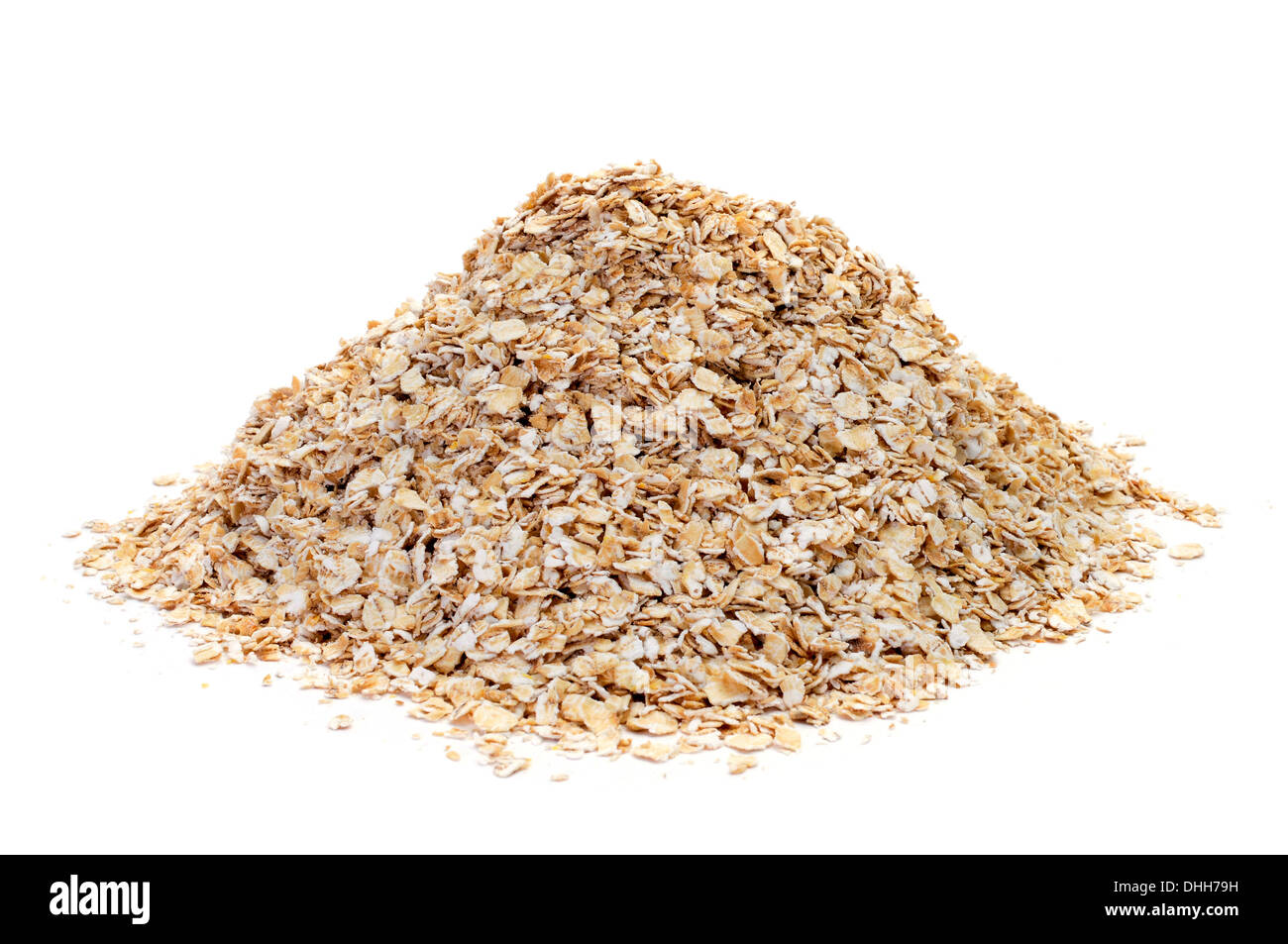 a pile of rolled oats on a white background - Stock Image